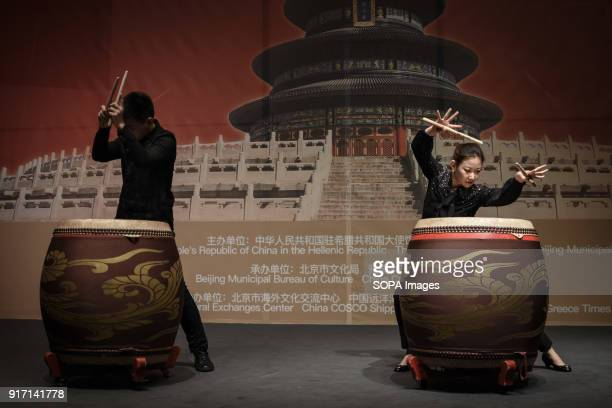Two musicians seen playing large drums during the 'Chinese New Year Night of Beijing' event The Beijing National Orchestra holds the Chinese New Year...