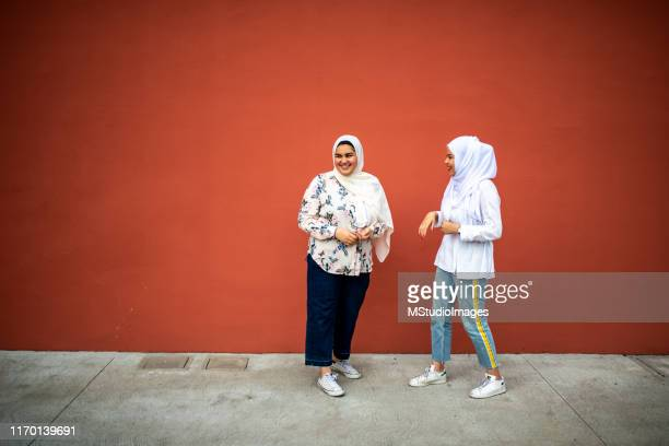 two muslim friends. - islam stock pictures, royalty-free photos & images