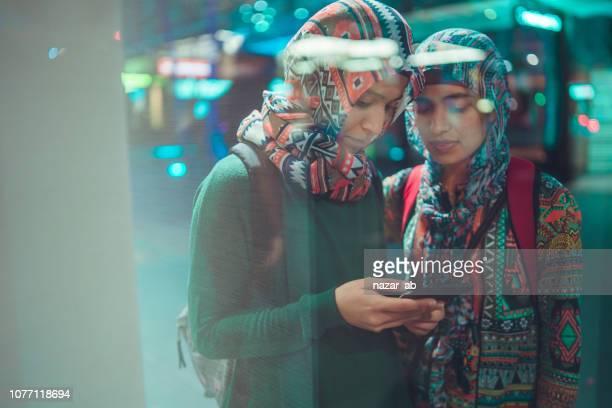 Two Muslim girls using social media.