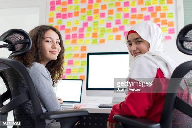 Two Muslim Girls Working on Computer