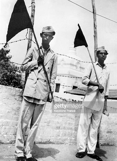Two Muslim Indians carrying black pennants and demonstrating against the partition of India and Pakistan on June 5 as the debate had been officially...