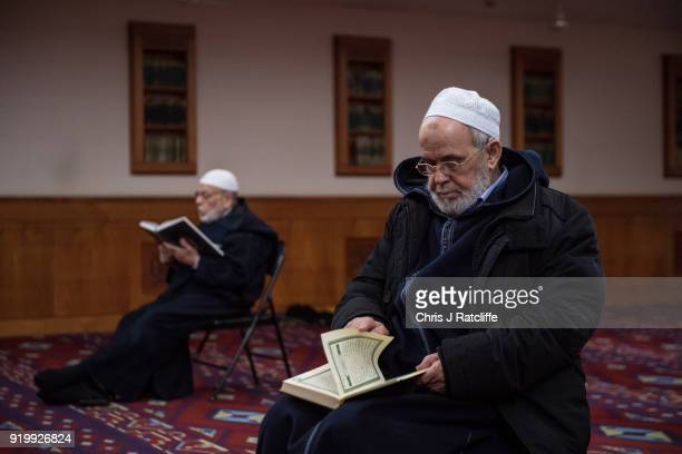 Two Muslim men read the Quran in the prayer room at Al Manaar mosque on Visit My Mosque Day on February 18 2018 in London England Visit My Mosque Day...