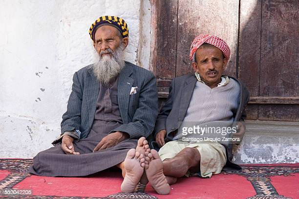Two Muslim men resting at a mosque Jibla Ibb Governorate Yemen Middle East