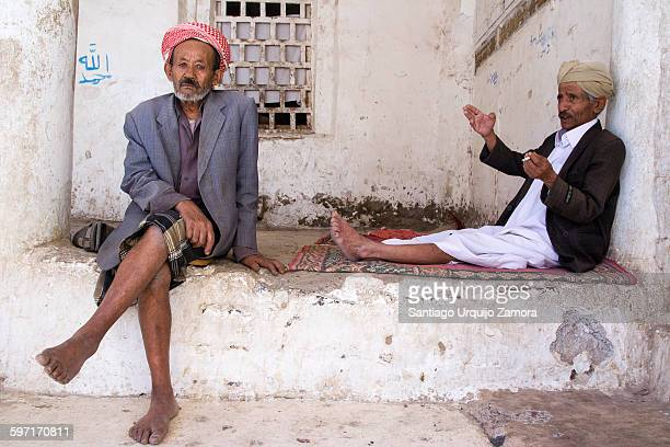 Two Muslim men resting inside a mosque Jibla Ibb Governorate Yemen Middle East