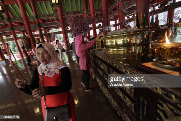 Two Muslim women are seen at a Lunar New Year celebration in the Sam Poo Kong temple in Semarang Central Java Indonesia on February 16 2018 The...