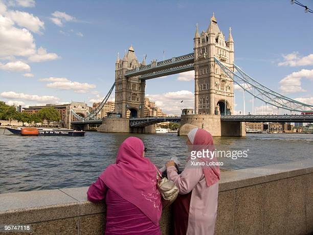 Two Muslim women look at the tower of London along the Thames 15th August 2008