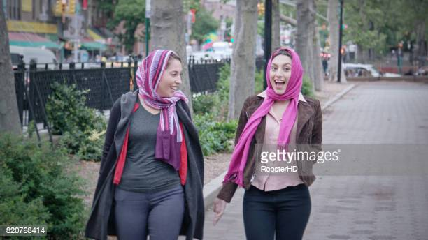 Two Muslim Women Walk Together in the City