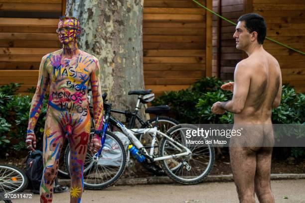 Two naked men prepare for the Naked Bike Ride 2018