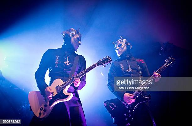 Two Nameless Ghouls of Swedish hard rock group Ghost performing live on stage at Reading Festival in Berkshire on August 29 2015