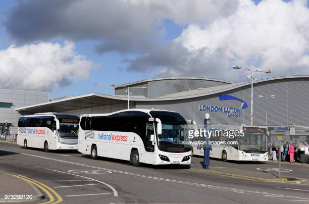 two National Express coaches parked in front of the Terminal at Luton Airport