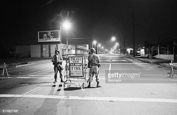 Two National Guardsmen watch the intersection of Imperial and Avalon in Watts on August 17 the day after the end of the violent rioting in the...