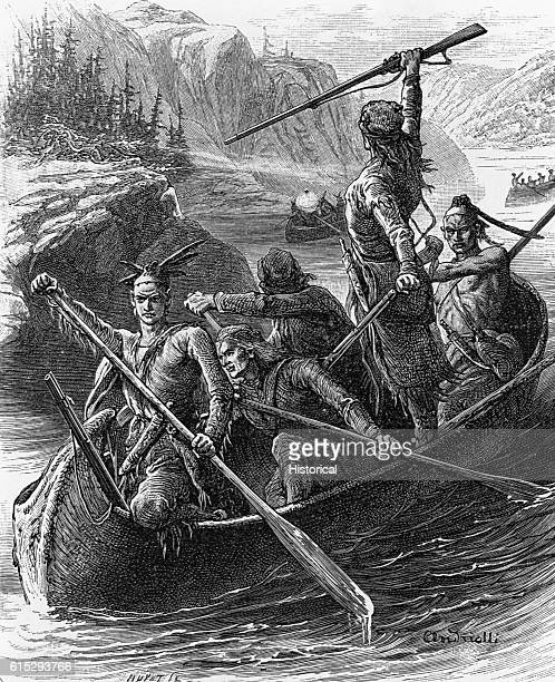 Two Native Americans and three settlers paddle a canoe on Lake George New York One settler holds up a rifle Two more canoes full of people follow...