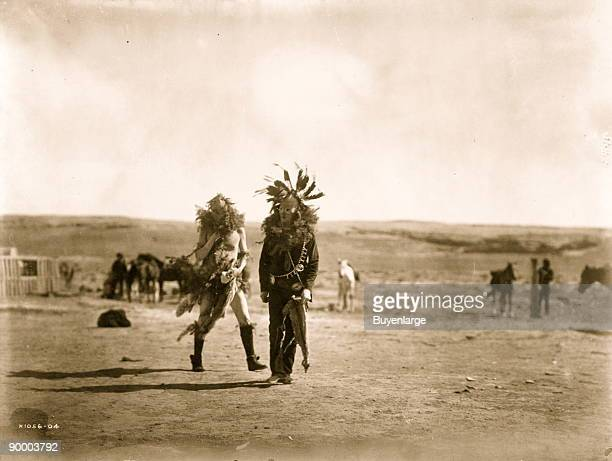 Two Navajo men impersonating two Yebichai Toneneli and Haschelti on the 6th day of the Yebichai ceremony