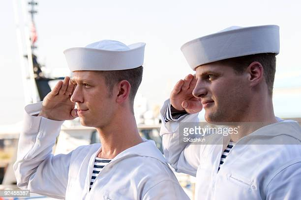 two navy sailors saluting on a ship - navy stock pictures, royalty-free photos & images