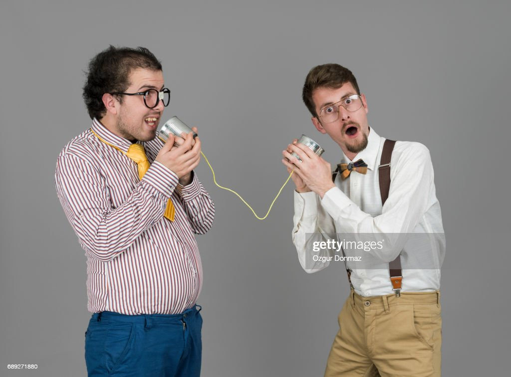 Two Nerd Men Holding Tin Can Phone : Stock Photo
