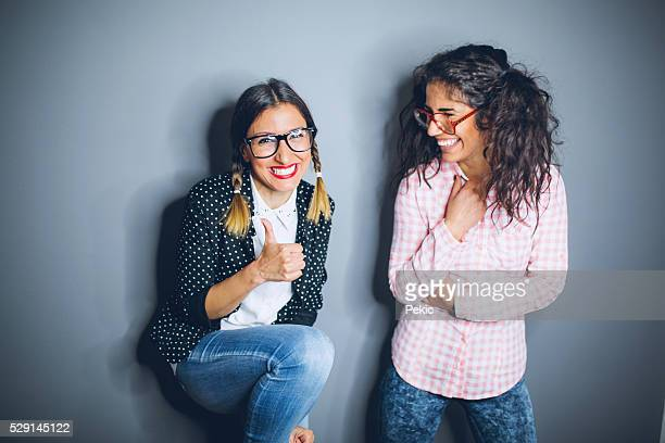 Two nerdy best friends giggling