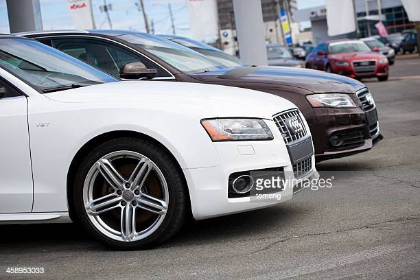two new audi vehicles in a row - two objects stock photos and pictures