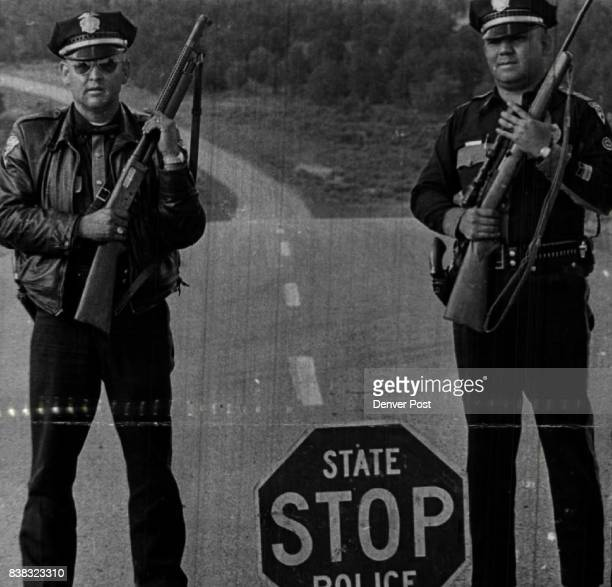 Two New Mexico State Policemen Man Roadblock on US 84 West of Canjilon during the search They are Senior Patrolmen Robert FVigil left and Lee...