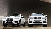 Two new white BMW X3 and X6 powerful SUV cars