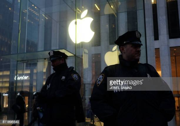 Two New York Police Department officers stand gaurd during a demonstration outside the Apple store on Fifth Avenue in New York on February 23 2016...