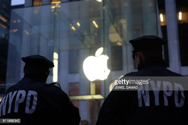 Two New York Police Department officers stand guard near the Apple store on Fifth Avenue in New York during an antigovernment demonstration on...