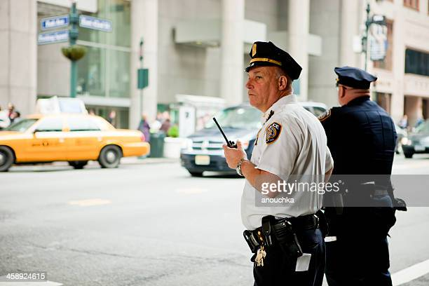 two new york policemen on duty, 42nd street - march month stock pictures, royalty-free photos & images