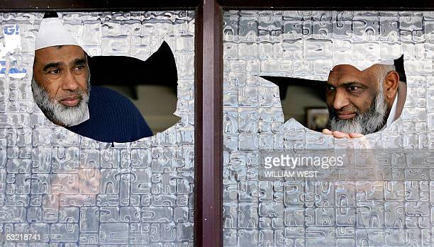 Two New Zealand muslims Nizam Shah and Riakat Ali Khan look thorugh broken windows at a mosque in the Auckland suburb of Ponsonby 10 July 2005 after...