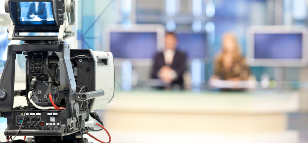 Two newsreader in front of television camera 157508633