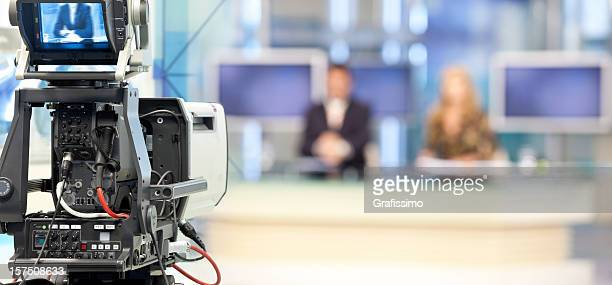two newsreader in front of television camera - television camera stock pictures, royalty-free photos & images