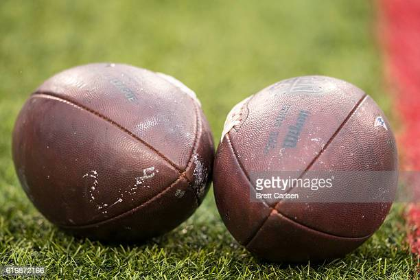 Two NFL footballs set on the field before the game between the Buffalo Bills and the New England Patriots on October 30 2016 at New Era Field in...