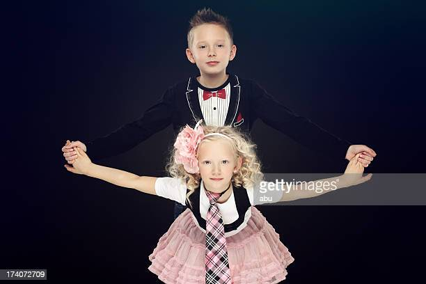 Two nice looking kids posing together