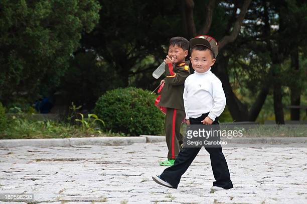 CONTENT] Two North Korean children in the park dominating Kaesong The park is used by locals in their spare time Some children wear militarylike...