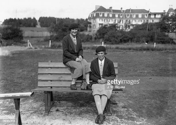 Two noted French women golfers Mlle Manette Le Blan and Mille Simone Thion de la Chaume pose at Le Touquet ready for the Autumn Golf Competitions