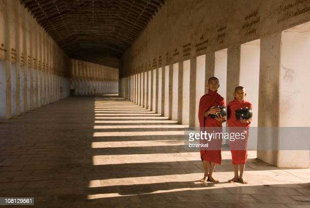 Two novice monks walking in the morning