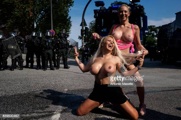 Two nude woman during riots on July 7, 2017 in Hamburg, Germany. German police and protesters clashed for three day during the G20 summit where...