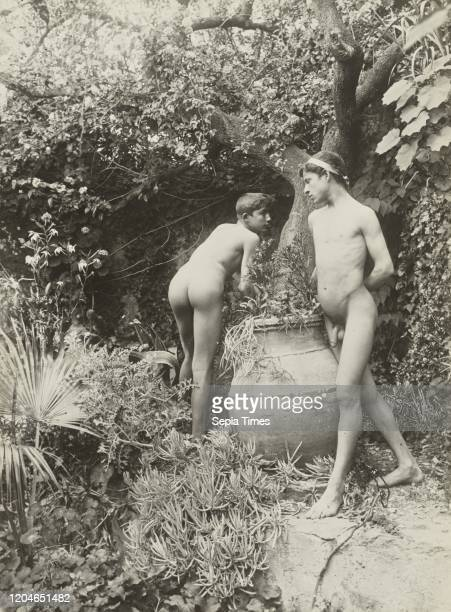 Two Nude Young Men in a Garden, Baron Wilhelm von Gloeden , 1899 - 1920, Gelatin silver print, 22.5 x 16.7 cm .