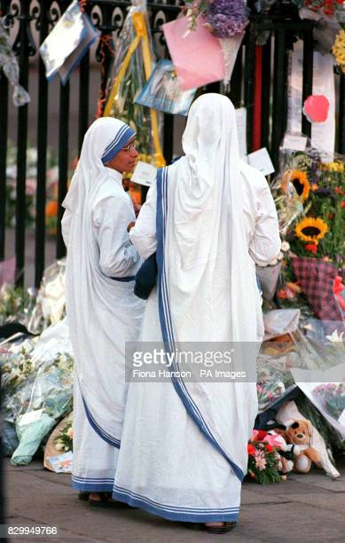 Two nuns from the order The Sisters of Loreto read tributes to Diana Princess of Wales outside Westminster Abbey today Mother Teresa a member of the...