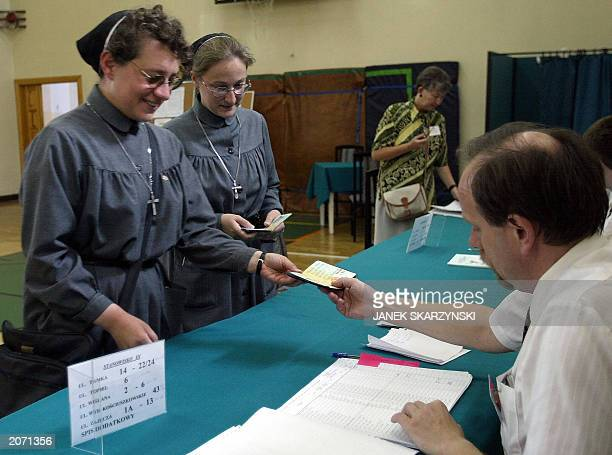 Two nuns from the Urszulanki convent the place from which Karol Wojtyla left for the conclave to Rome to become Pope are checking their names on the...