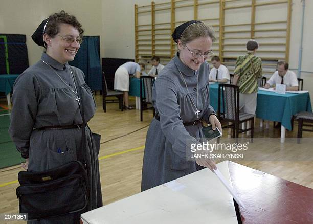 Two nuns from the Urszulanki convent the place from which Karol Wojtyla left for the conclave to Rome to become Pope are casting their votes in to...