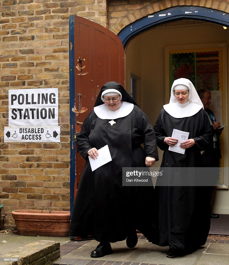 Two Nuns from Tyburn Convent leave a polling station at St Johns Parish Church after casting their vote on May 6, 2010 in London, United Kingdom. After 5 weeks of campaigning, including the first ever live televised Leader�s Debates, opinion polls suggest that the UK is facing the prospect of a hung parliament for the first time since 1974.