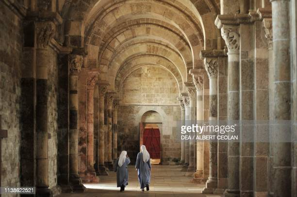 Two nuns in a side aisle of Saint Mary Magdalene Basilica Vezelay BurgundyFrancheComte France 12th century
