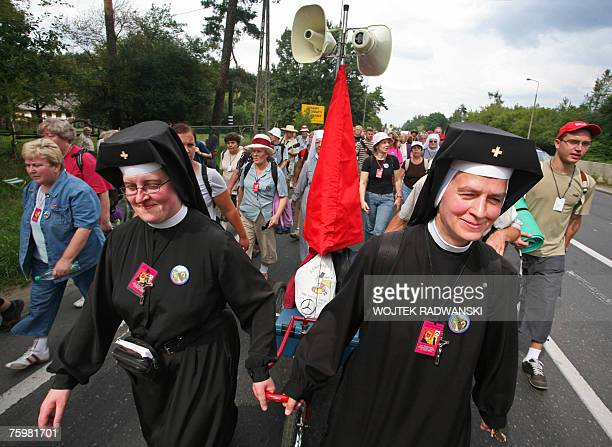 Two nuns pull a tricycle amongst a group of pilgrims from Warsaw as they walks through a Warsaw suburb 06 August 2007 as they take part in an annual...
