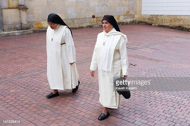Two nuns walk on a side street in downtown on January 29 2012 in Bogota Colombia