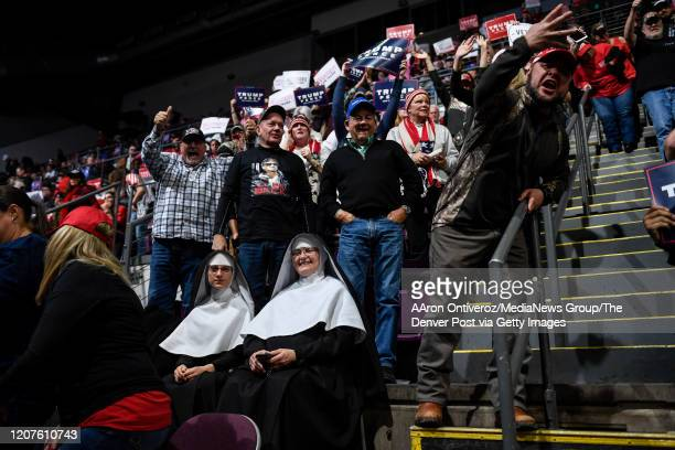 Two nuns who asked to be identified as The Sisters sit in the crowd as Marcus Lee throws up four fingers to indicate a reelection for President...