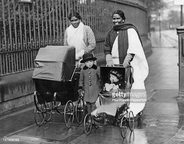 Two nursemaids from Madras with their young charges on the Great Western Road in Glasgow circa 1925