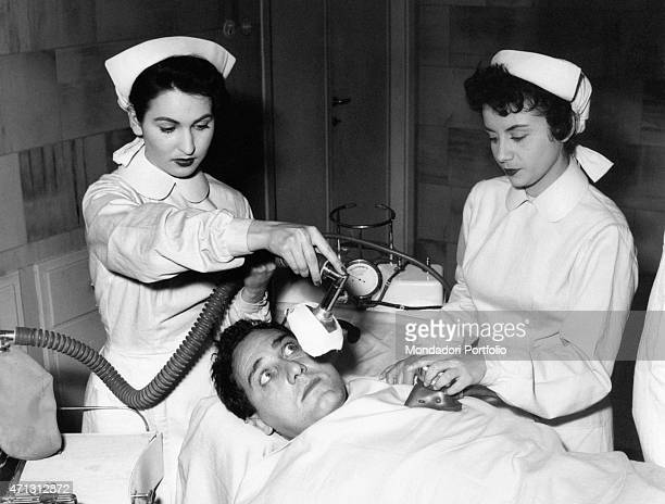 Two nurses seeing Italian actor and director Alberto Sordi in the film A hero of our times Rome 1955