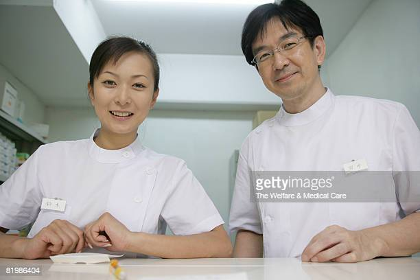 Two nurses standing at information counter, smiling