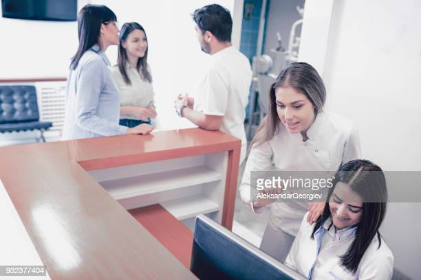 Two Nurses Work While the Doctor Talks to New Dental Students for their Professional Practice