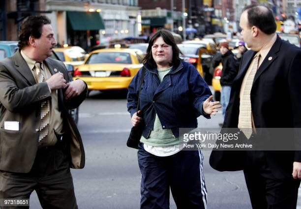 Two NYPD detectives talk to Lorraine House who is homeless as they walk her to a police car for questioning House claims to have witnessed a woman...
