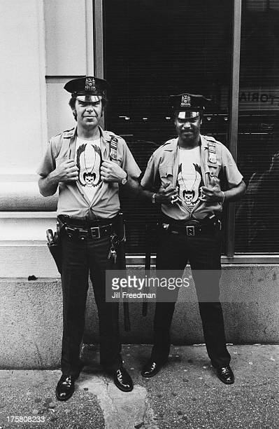 Two NYPD officers show off their bullet proof vests with the Hells Angels insignia New York City 1980